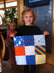 Gabby's first quilt block, her sister Audrey can't wait to start quilting..then Gabby will make faces in the background. LOL